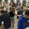 Physics Students Use Skills to Judge Science Fair