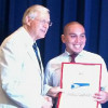 Postmaster Honored for Work With Children