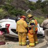 Two Vehicles Plummet Off Side Of Freeway, Land On Old Road