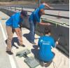 Volunteers Paint Fallen Warriors Bridge