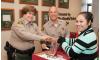 Volunteers Prepare Gifts for Women in Lockup