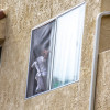 Parents of Child Rescued from Window Appear in Court