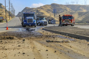 Truck, EV Crash Causes Fuel Spill on Sierra Highway