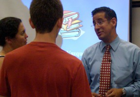 Marcelo Vazquez of Cal State University, Los Angeles provides some one-on-one advice at Wednesday's College & Career Fair.