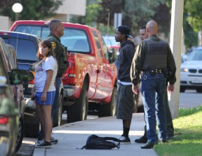 10/31/2011: One of the suspects is taken into custody following a fatal shooting in a Canyon Country parking lot.