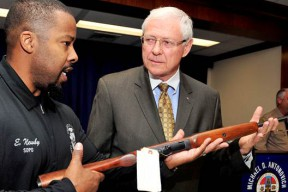 Antonovich and Eric Newby of the Probation Department take aim at violators.