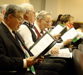 The Silver Toned Signers opened the annual gavel-passing ceremony with Christmas carols.