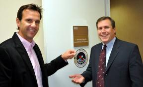 Former Assemblyman Cameron Smyth (left) hands the keys to Assemblyman Scott Wilk at Smyth's old office in late November.