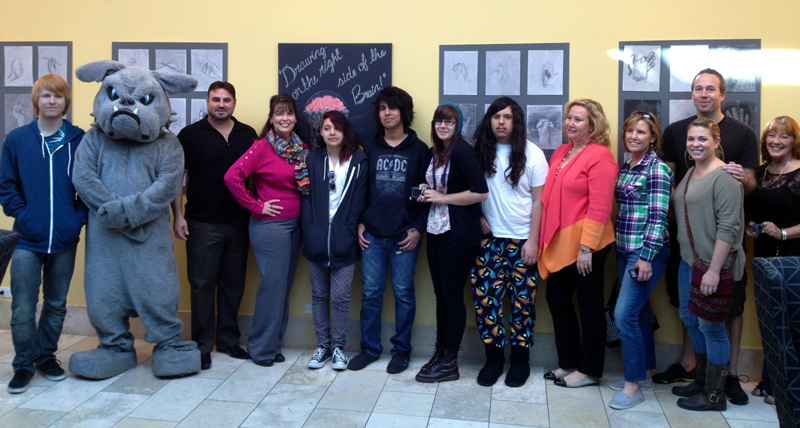 "Bowman students with their exhibit, ""The Left Brain: Art from Bowman High"""