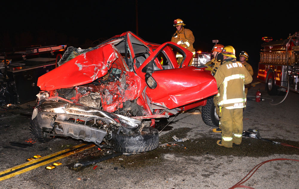 LA County firefighters work to extricate victim of head on collision on Sierra Highway s/o Davenport Rd. in Canyon Country Friday night. Photo by Rick McClure