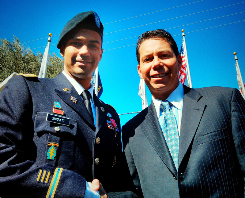 Bronze Star recipient Capt. Gabe Surratt stops for a photo with Fred Arnold, chairman of the SCV Chamber of Commerce. (SCVTV)