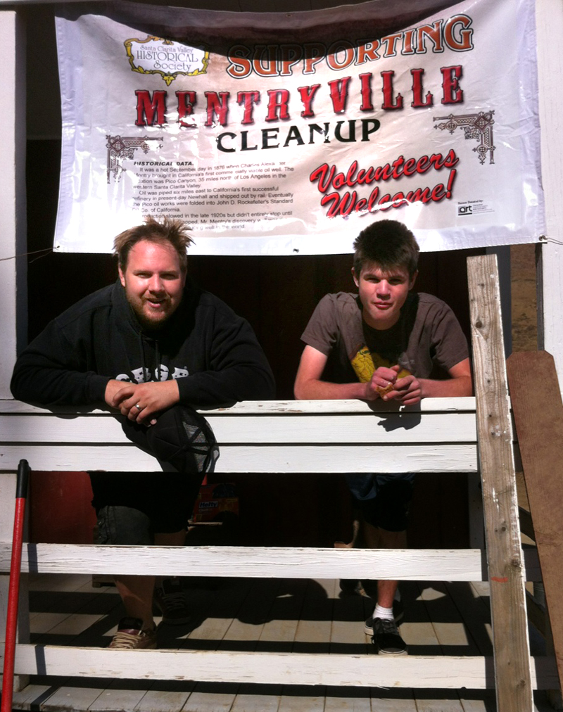 SCVi Charter School instructor Luke Salzarulo and student Evan Decker take a quick break from sprucing up the Felton School at Mentryville this weekend.