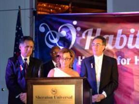 KHTS co-owner Jeri Seratti-Goldman receives the Hammer of Hope award