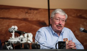 Pete Theisinger with a model of the Curiosity rover in 2012 (NASA photo)