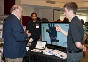 Members of the first place-winning team explain their Assisted Gripping Rig at a recent university showcase. Photo: CSUN/Lee Choo