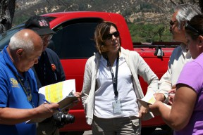 "Virgilio ""Gil"" Macion of the U.S. Small Business Administration (far left) , Michael Hooper of the Los Angeles County Office of Emergency Management, Sonia Brown of the Cal EMA Southern Region, Francis Dominguez of the Los Angeles County Department of Public Works and Theresa Gonzales of Cal EMA discuss property impacted by the Powerhouse Fire during a joint Preliminary Damage Assessment conducted by Cal EMA and the SBA on June 17 to verify fire-related damages. CalEMA"