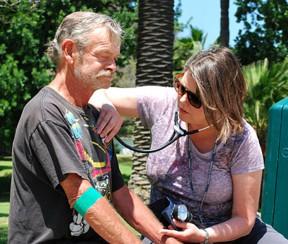 "Veteran Mark Fields relaxes while VA ""street nurse"" Janel Perez takes a listen. Photo by Scott Hathaway/VA Greater Los Angeles"