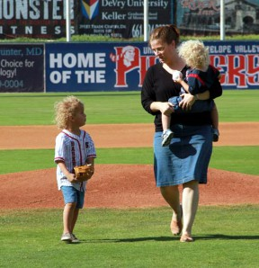 Benjamin throws out the first pitch at a Jethawks game for his second birthday.