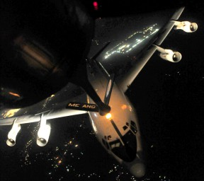 A KC-135 Stratotanker refuels a Joint Surveillance Terminal Attack Radar System (JSTARS) over Iraq, Dec. 18, 2011. The JSTARS mission was the last over Iraq during Operation New Dawn. The JSTARS provided airborne, stand-off range, surveillance and target acquisition radar, and command and control capabilities to ground personnel. (U.S. Air Force photo/Senior Airman Tyler Placie)