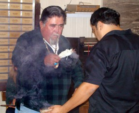 Charlie Cooke, left, performs the blessing at the SCV Historical Musuem upon the transference of artifacts from Newhall Land's River Village development site in 2007, Receiving the blessing is Rudy Cook Jr., current tribal captain of the Fernandeño-Tataviam Band of Mission Indians.