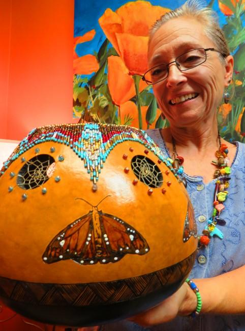 Local artist Nadiya Littlewarrior displays one of her gourd pieces.