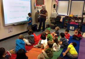 Rikki Fayne teaches her Golden Oak kindergarten class about the number line using a SMART Board. Photo: KHTS