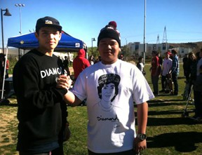 Bowman High School student Cody Le (right) organized the event with help from other teens including Joseph Aquilar of West Ranch High School (left). Photo: KHTS