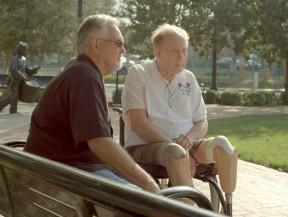 Vietnam veteran Bill Reynolds (left) with fellow Charlie Company veteran Jack Benedick at Veterans Historical Plaza in Newhall. Photo: Lou Reda Productions.