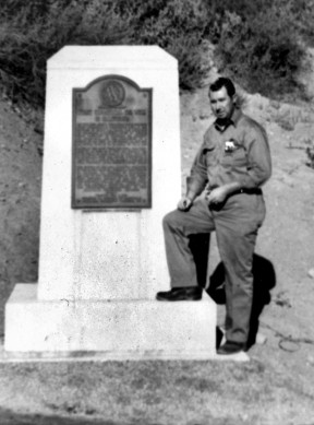 Alton Manzer, the writer's father, at the monument for the historic oil well in Pico Canyon.