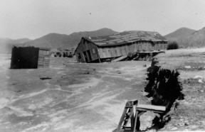 Structures in Acton wash downriver in the Great Flood of March 2, 1938. (File photo/SCVHistory.com)