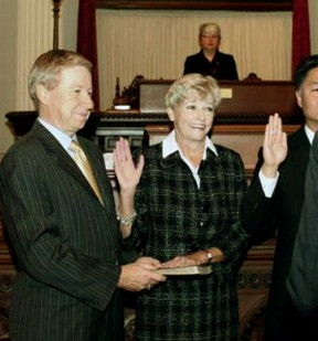Been there, done that: Sharon Runner takes the oath of office in 2011 after her husband George (left) was elected to the Board of Equalization.