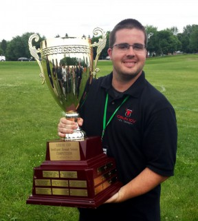 Mechanical engineering senior, Erik Wagner, holds the first place trophy at the 2015 International Ground Vehicle Competition at Oakland University in Michigan. Photos: C.T. Lin/CSUN