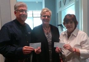 Sue Endress (center) presents checks to Lou Esbin of Rotary and SuzAnn Nelson of the SCV Senior Center.
