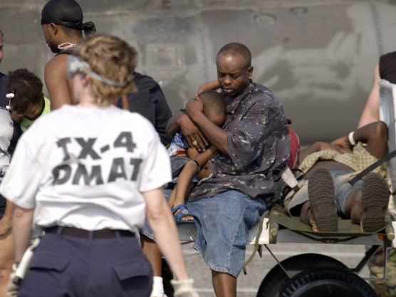 (September 3, 2005 New Orleans) -- Evacuees and patients arive at New Orleans airport where FEMA's D-MATs have set up operations.  Photo: Michael Rieger/FEMA