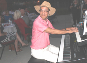 Ray Lowe provided the music to accompany the silent films at the Friends of Hart Park fundraiser. Photo by Michele E. Buttelman.
