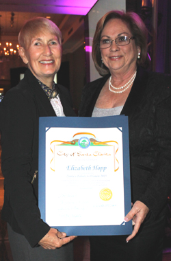 City Councilwoman Laurene Weste. left, presents Elizabeth Hopp with a certificate of recognition at Zonta's Tribute to Women 2015. Photo by Michele E. Buttelman.