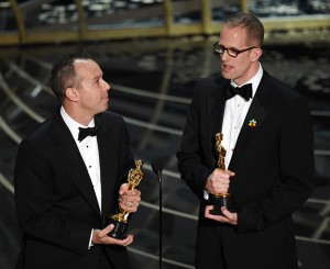 """Producer Jonas Rivera (leff) and director Pete Docter accept the Best Animated Feature Film award for """"Inside Out."""" Photo: AMPAS"""