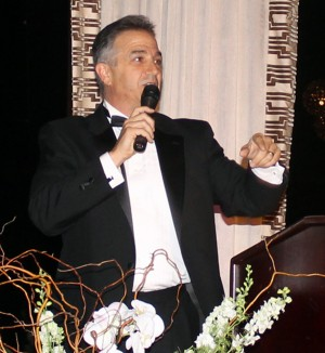 Volunteer auctioneer Chris Fall hammered down $18,200 for 10 items in the live auction.