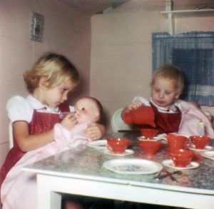 Daughters Marla and Debbie have a tea party upstairs in the depot in the 1960s.