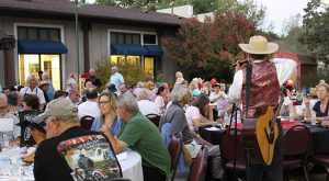 """Mild Bill"" entertains guests in the backyard at Hart Hall adjacent to Hart Park in Newhall."