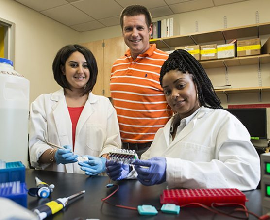 From left: CSUN biology graduate student Yvess Adamian, biology professor Jonathan Kelber, and biology graduate student Malachaia Hoover work recently published an article announcing a novel and groundbreaking method to extracting RNA from tissue samples. Photo by David J. Hawkins.