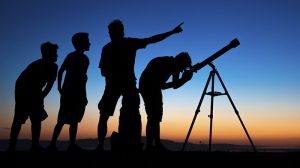Dad and three sons on a clear night looking thru a telescope Check out this light box with other Astronaut/Space Images by Nashville Photographer, Dieter Spears, Owner of Inhaus Creative. [url=http://www.istockphoto.com/search/lightbox/2459726#898cb29][img]http://dieterspears.com/istock/links/button_space.jpg[/img][/url]