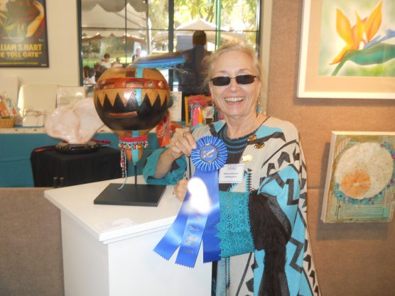 Nadya Littlewarrior and 'Crooked Face,' 2016 Sculpture winner.
