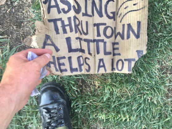 arrested panhandler's sign
