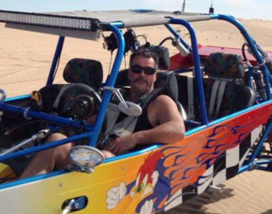 John Phippen in dune buggy