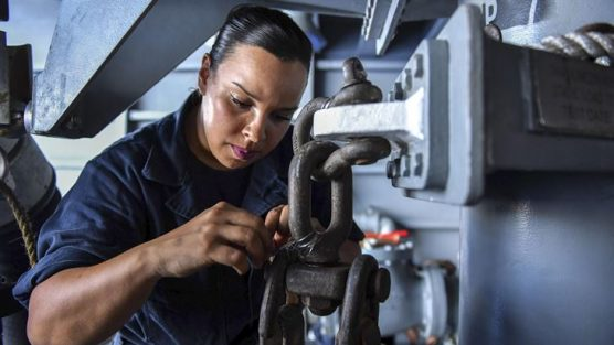 Navy Seaman Cassandra Liriano seizes a block in a fueling sponson aboard the USS Theodore Roosevelt in the Pacific Ocean, Nov. 8, 2017. Navy photo by Petty Officer 3rd Class Anthony J. Rivera.