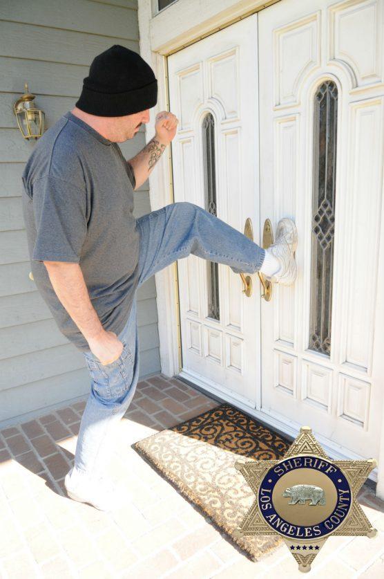 residential burglar kicking door