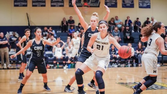 Freshman Anika Neuman (21) has been the Mustangs' go-to option in the post this season. She's second on the team in scoring and first in rebounds.