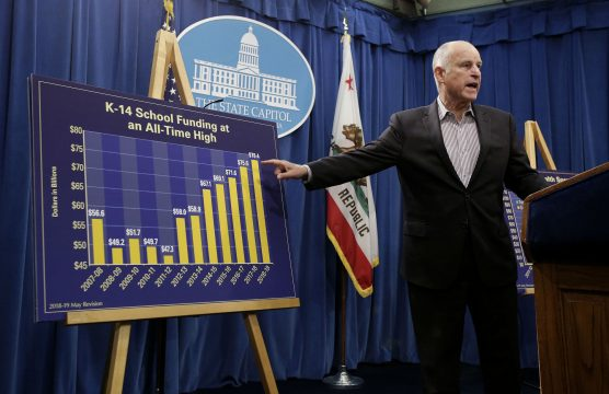 Gov. Jerry Brown gestures toward a chart showing the increase in K-14 school funding, while discussing his revised 2018-19 state budget at a Capitol news conference Friday, May 11, 2018, in Sacramento, Calif. (AP Photo/Rich Pedroncelli via Courthouse News Service)