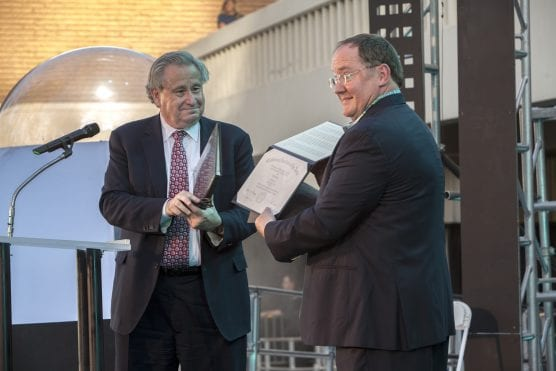 CalArts President Steven Lavine presents John Lasseter with an Honorary Doctor of the Arts degree citation on May 16, 2014.
